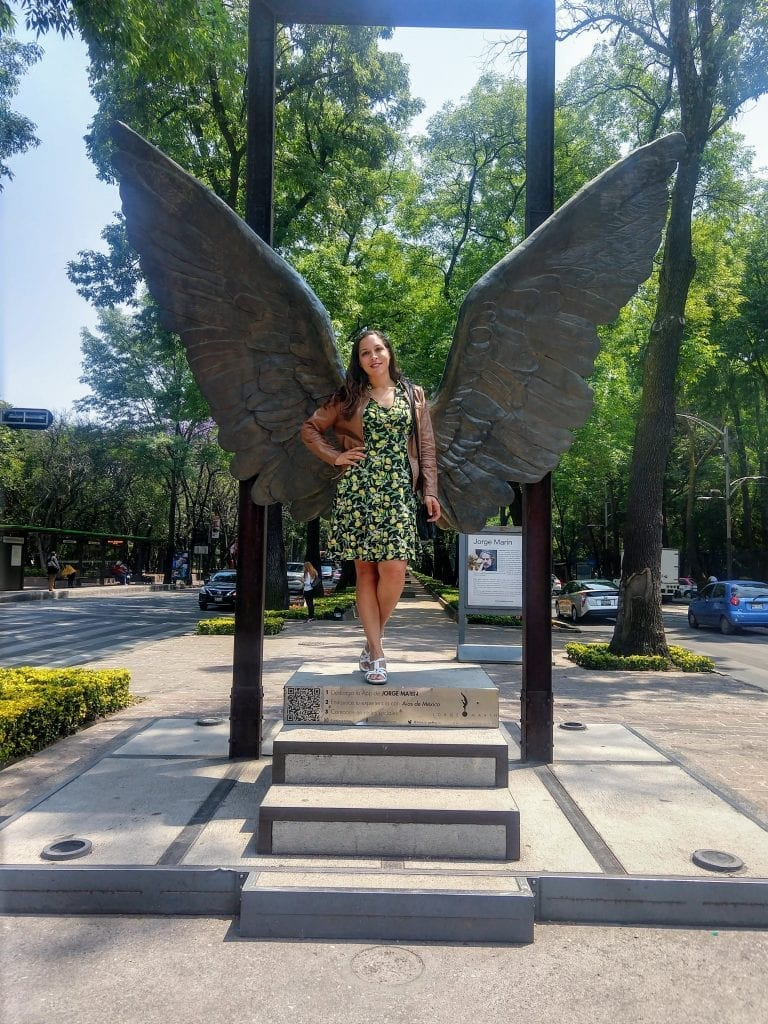 Sarah Fay in front of Angel Wings in Chapultapec in Mexico City CDMX