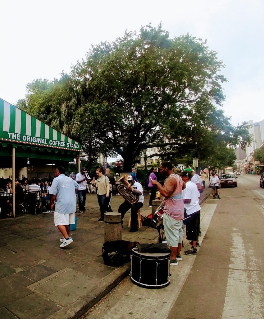 Brass Band Plays outside of Cafe Du Monde in New Orleans.