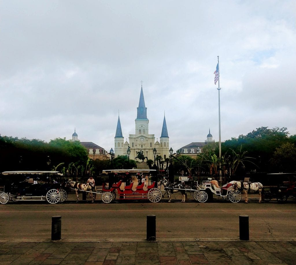 Horse Drawn Carriages in front of Jackson Square in New Orleans a romantic scene.