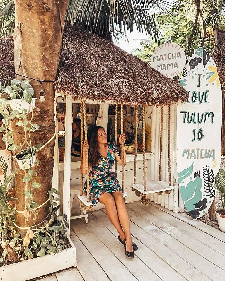 Sarah Fay travel blogger on swing in front of Matcha mama in tulum Mexico