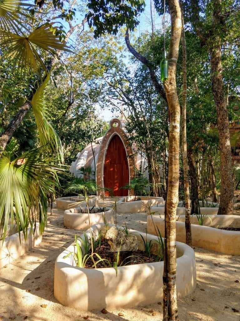 Holistika entrance to yoga and meditation room surrounded by jungle in Tulum Mexico,