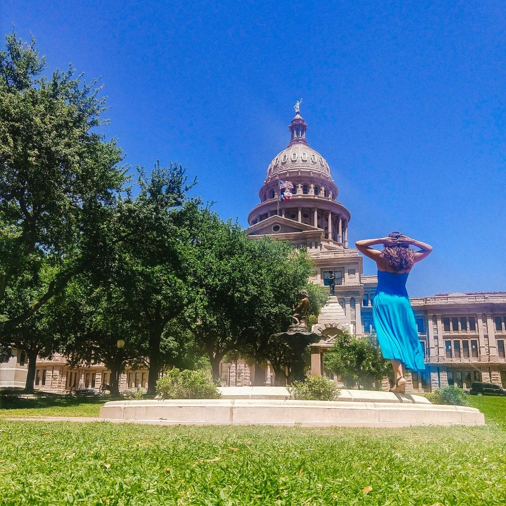Sarah Fay travel blogger in front of the Texas Capital Building in Austin Texas.