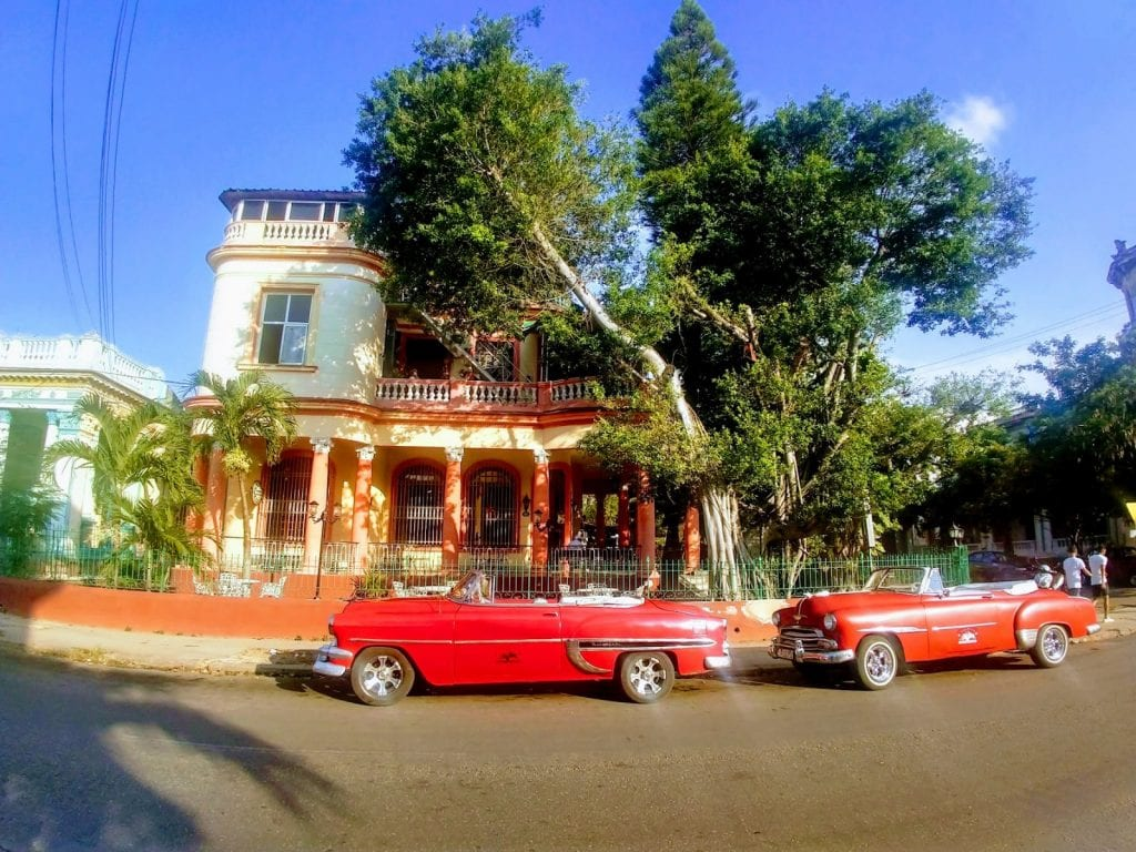 Old school red cars from the 1960s in Havana , Cuba.