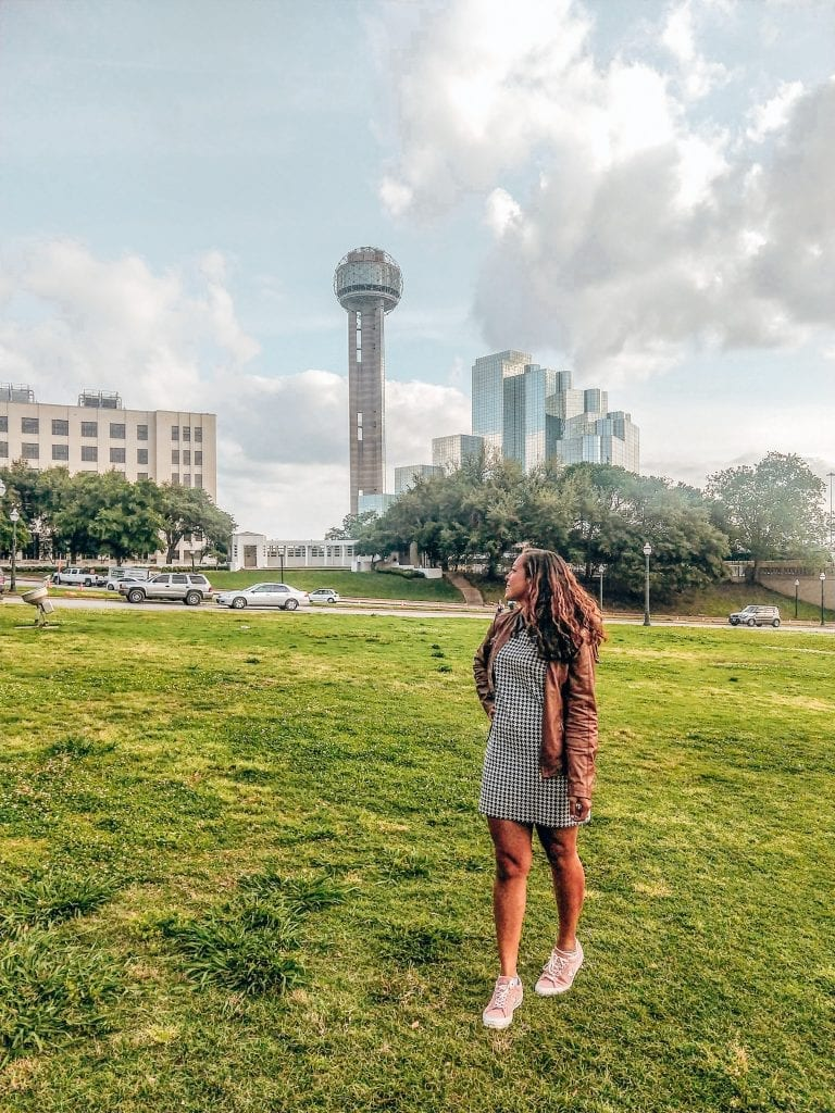 Sarah Fay travel blogger in front of Reunion Tower in Dallas Texas.