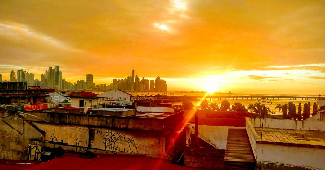 Sunrise over Panama City, Panama from the viewpoint of Casco Viejo at Selina Hostel.