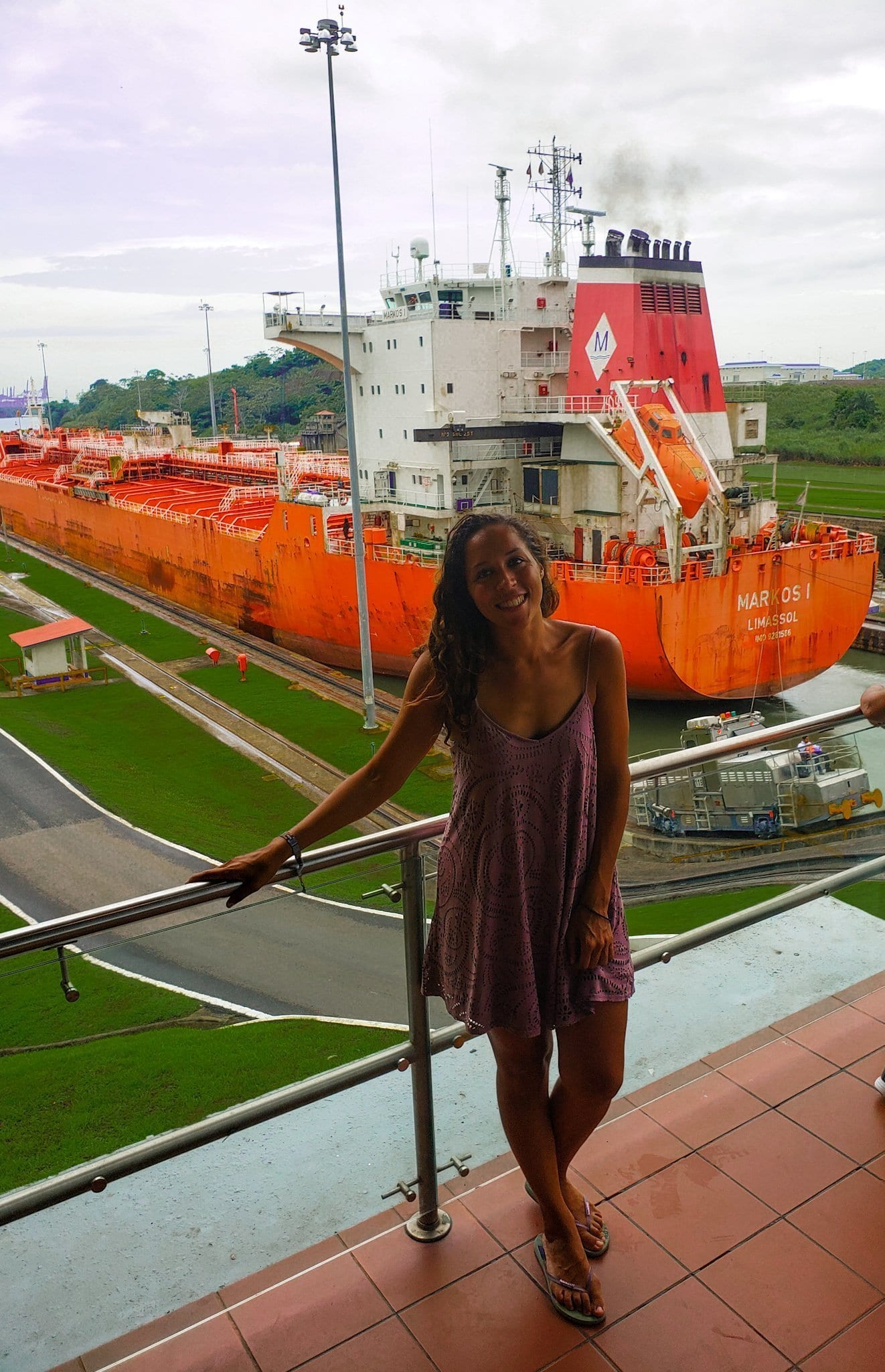 Sarah Fay in front of the Panama Canal Miraflores Lock.