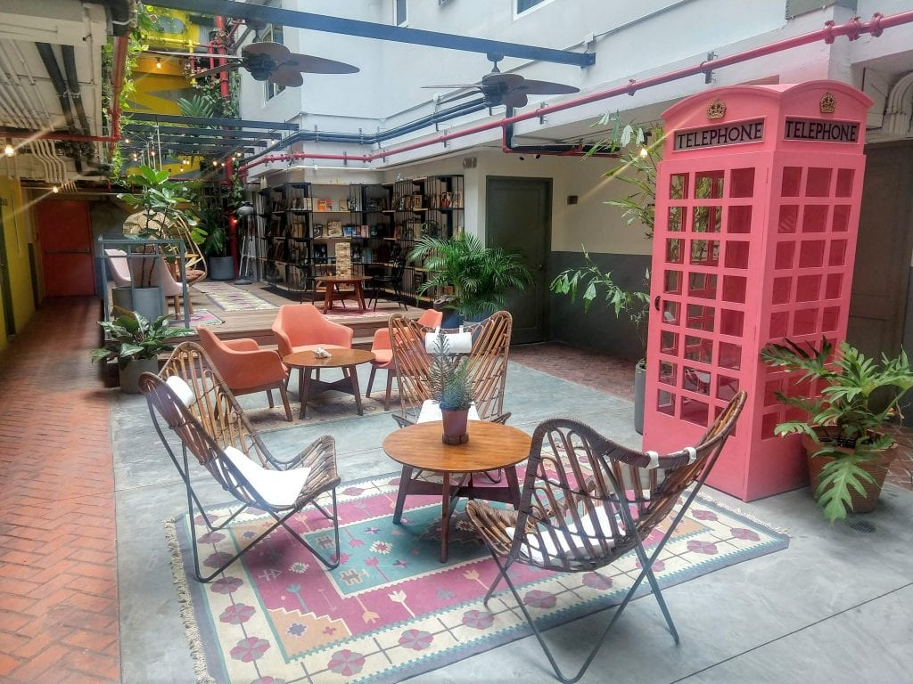 Selina Hostel lounge in Casco Viejo Panama City with chairs, library, and comfortable hang out areas.