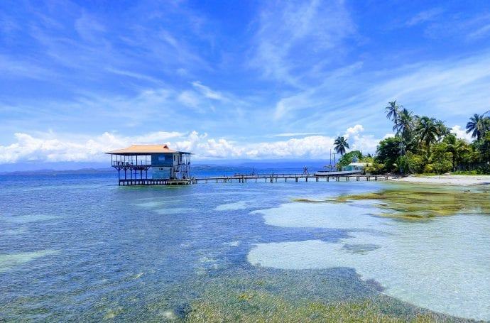 Bocas Del Toro is a beautiful island archipelago in Panama. The blue clear waters with docks jutting out into the water are superb for island hopping. White sand beaches and crystal clear blue waters are what makes this place one of the best island destinations in the Caribbean. #BocasDeltoro #visitpanama