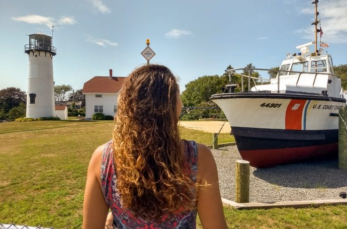 Chatham lighthouse and coast guard boat in Cape Cod with Sarah Fay facing it.