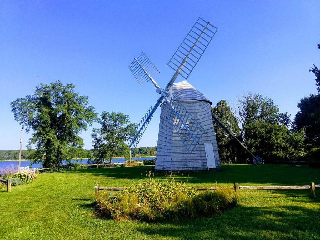 Windmill in Cape Cod in Orleans Massachusetts on a sunny day with blues skies.