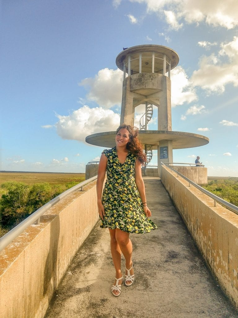Sarah Fay standing on top of Shark Loop Overlook in Everglades National Park overlooking the vastness of the Everglades. #visiteverglades #visitflorida
