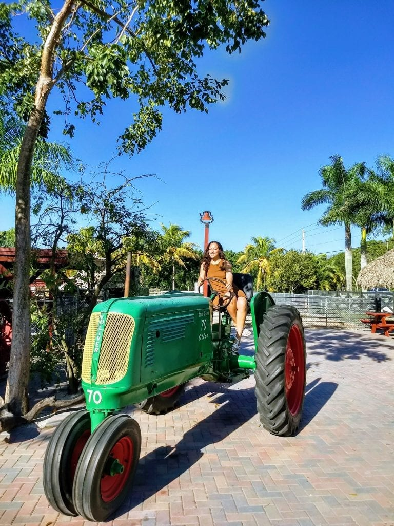 Sarah Fay travel blogger on tractor at Robert is Here fruit stand. #VISITFLORIDA #everglades