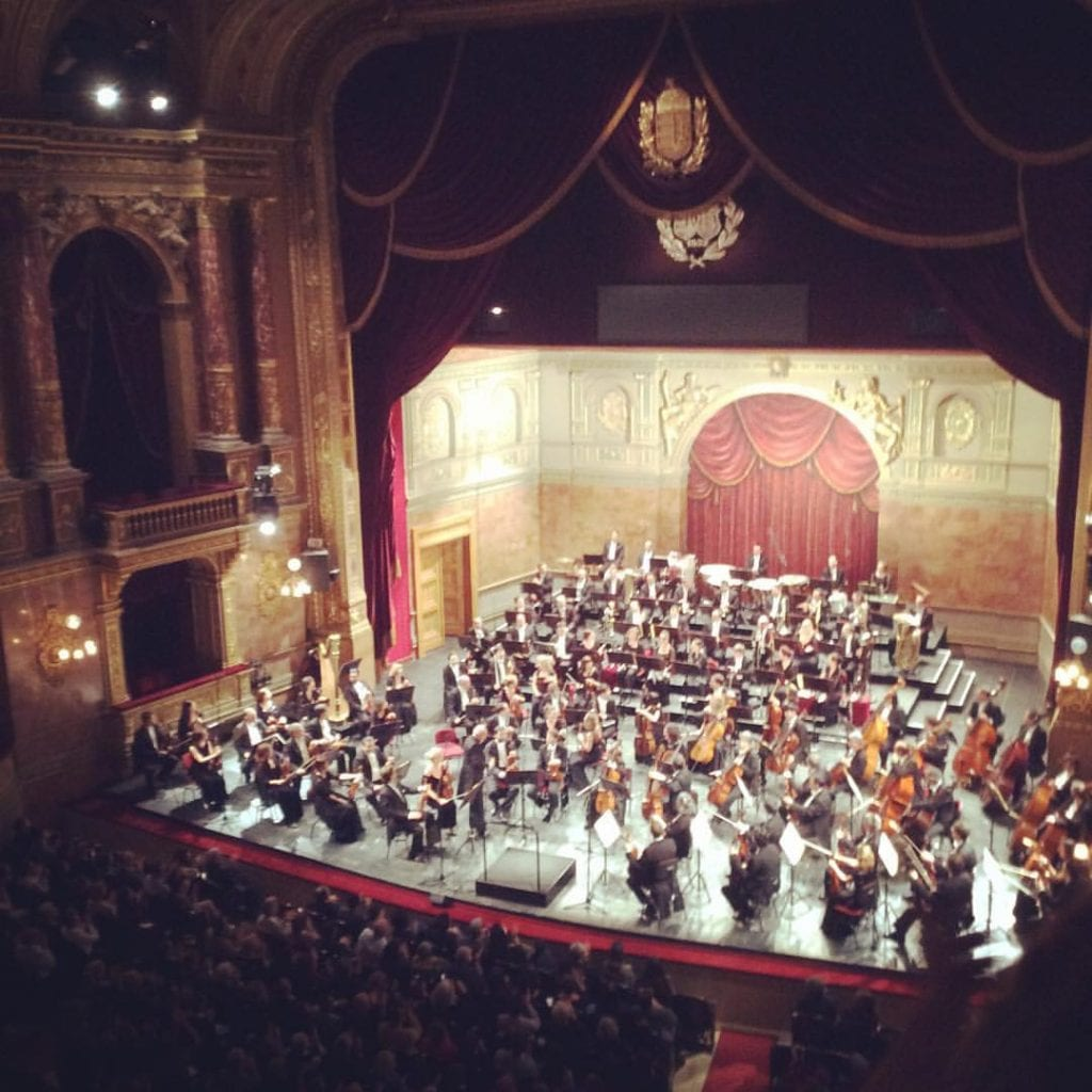 Watching the symphony at the Budapest Opera House where you can get tickets for $5 USD. #VISITBUDAPEST #budapesttravelguide