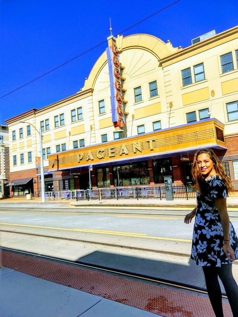 Sarah Fay in front of the Pageant theater on the Delmar Loop in Saint Louis, MO.