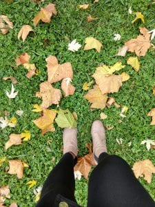 Feet among fall folliage