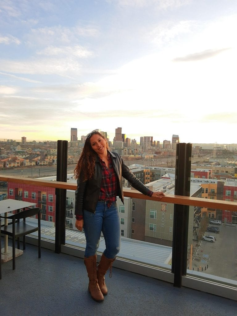 Sarah Fay travel blogger at the Source rooftop in the artsy neighborhood of RHINO District in Denver, Colorado. #visitdenver
