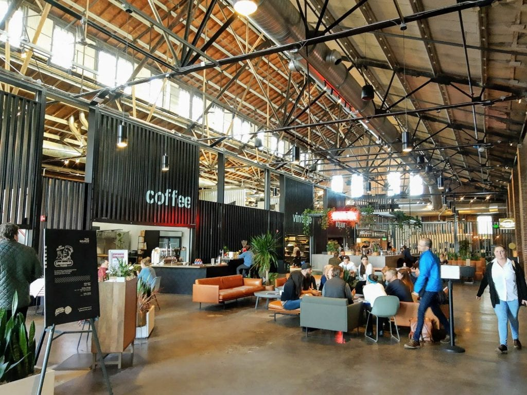 Inside The Source Market with restaurants and a food market vibe with people shopping.