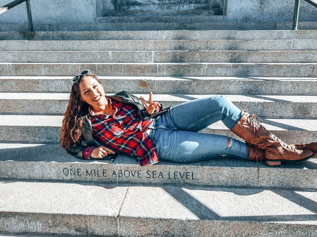Sarah Fay laying on the mile high step in the mile high city of Denver, Colorado. #visitdenver