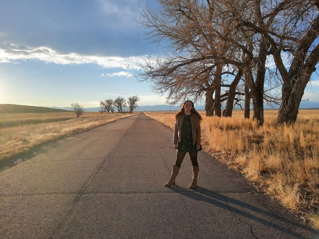 Sarah Fay standing in the middle of the Arsenal National Wildlife Refuge in Denver