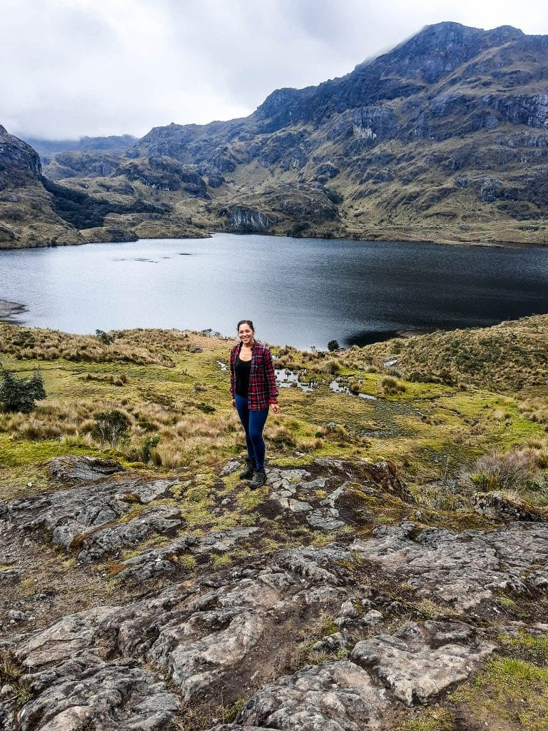 Sarah Fay travel blogger in Cajas National Park near Lake Toreadora on a cloudy day outside of Cuenca, Ecuador. #visitecuador #cajasnationalpark