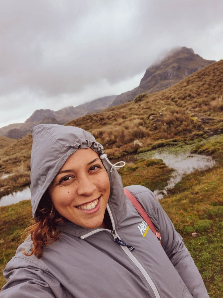 Rainey weather, cold at high altitudes, and Sarah Fay travel blogger trying to keep warm at Cajas National Park. #visitecuador