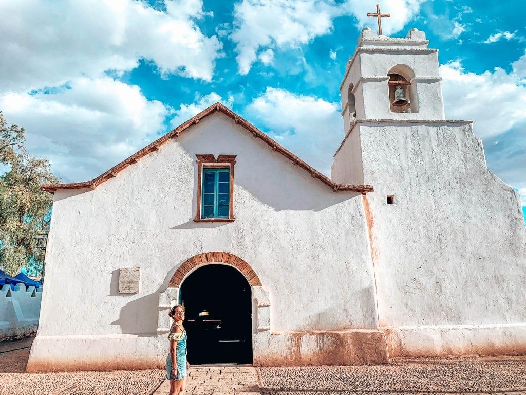 17th century Church of San Pedro De Atacama in Chile. Sarah Fay during the summer in San Pedro De Atacama in front of the church.