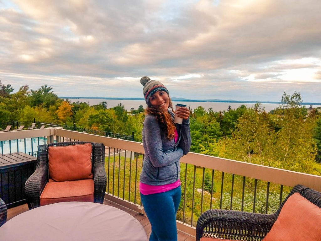 Sarah travel blogger having coffee at the lodge in Acadia National Park