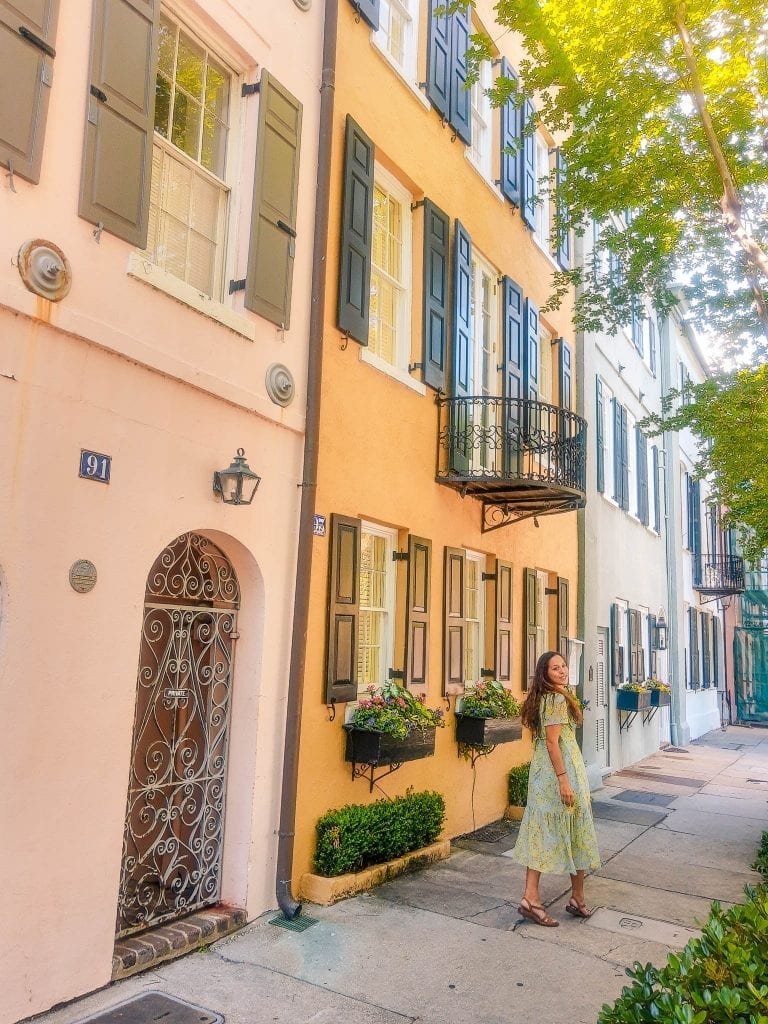 Rainbow Row in Charleston, SC is a historic row of Georgian Houses painted with pastel colors.