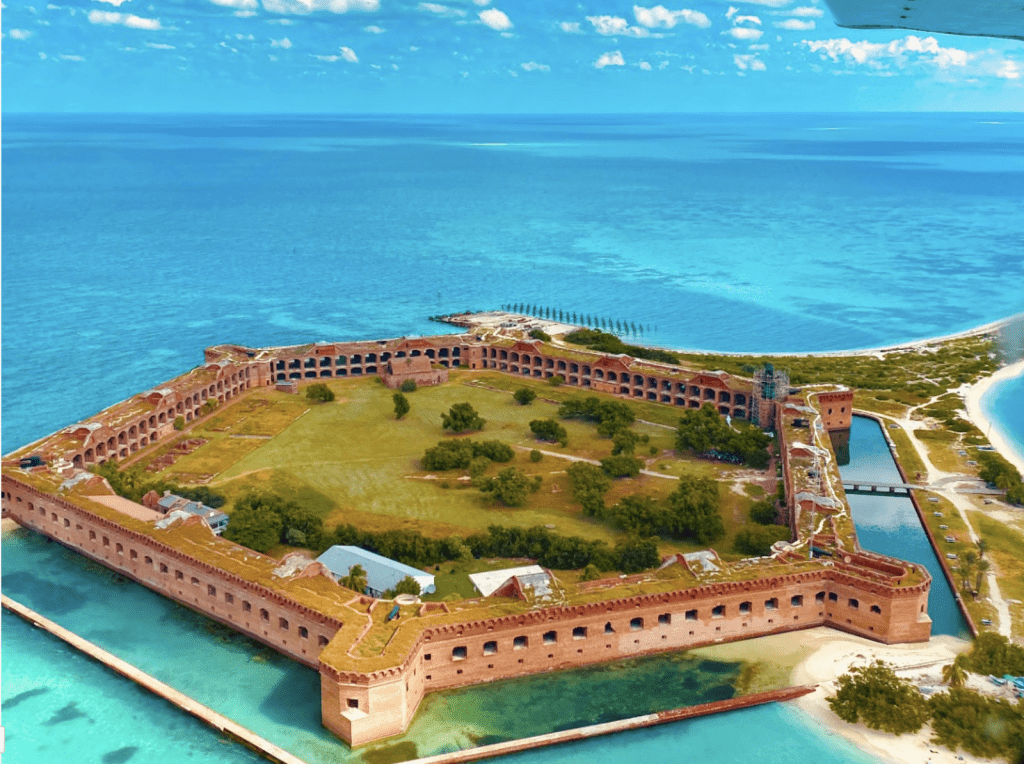 Aerial Photo of Dry Tortugas National Park on a sunny day with the blue ocean in the background.