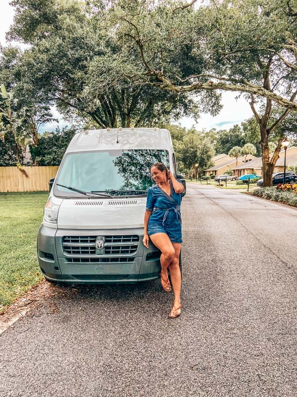 Sarah Fay in front of her Dodge Promaster she is converting for van life.