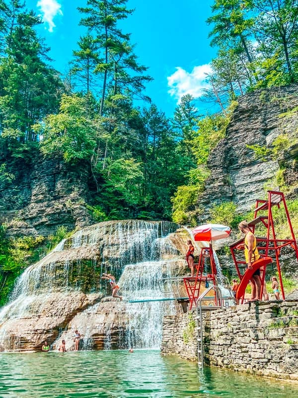 Robert H. Treman State Park Falls diving board and waterfalls swimming area in Finger Lakes.
