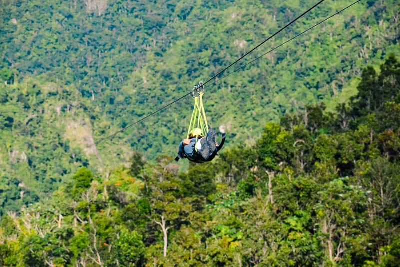 Sarah Fay going down the Toro Verde one of the fastest and longest zipline