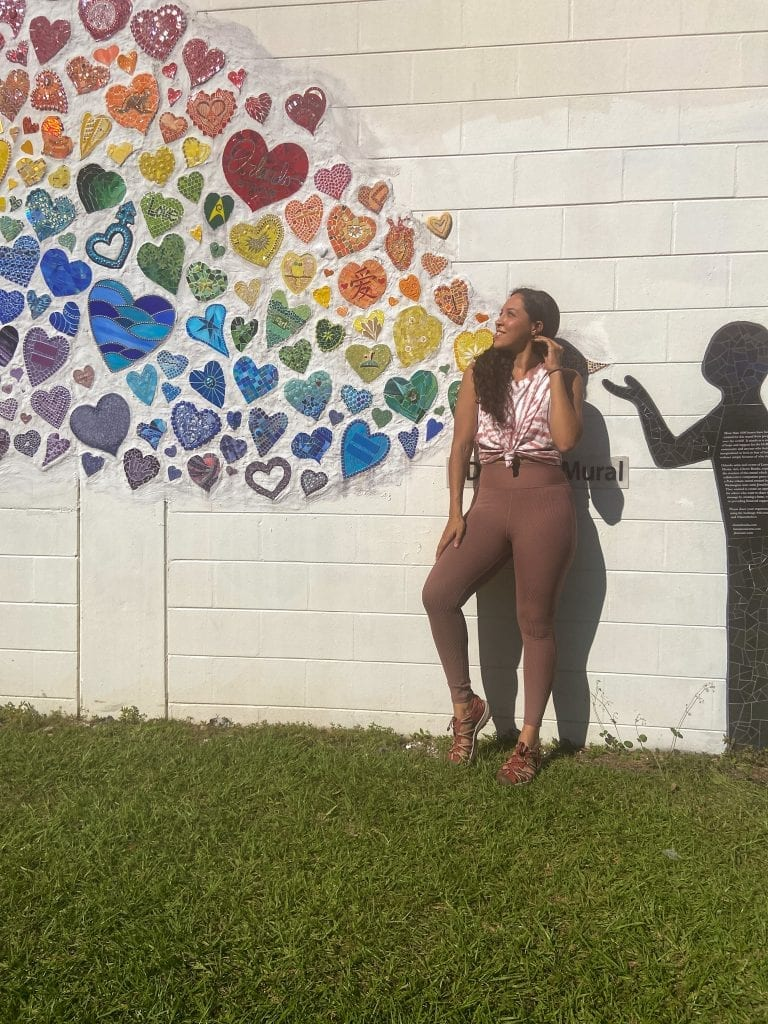 Free people movement set in front of diversity mural with hearts. Wantable Active Edit