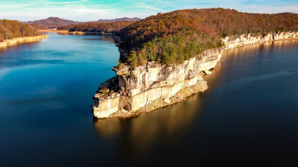 One of the best things to do in West Virginia is a sunrise hike on Long Point Trail on Summersville Lake.