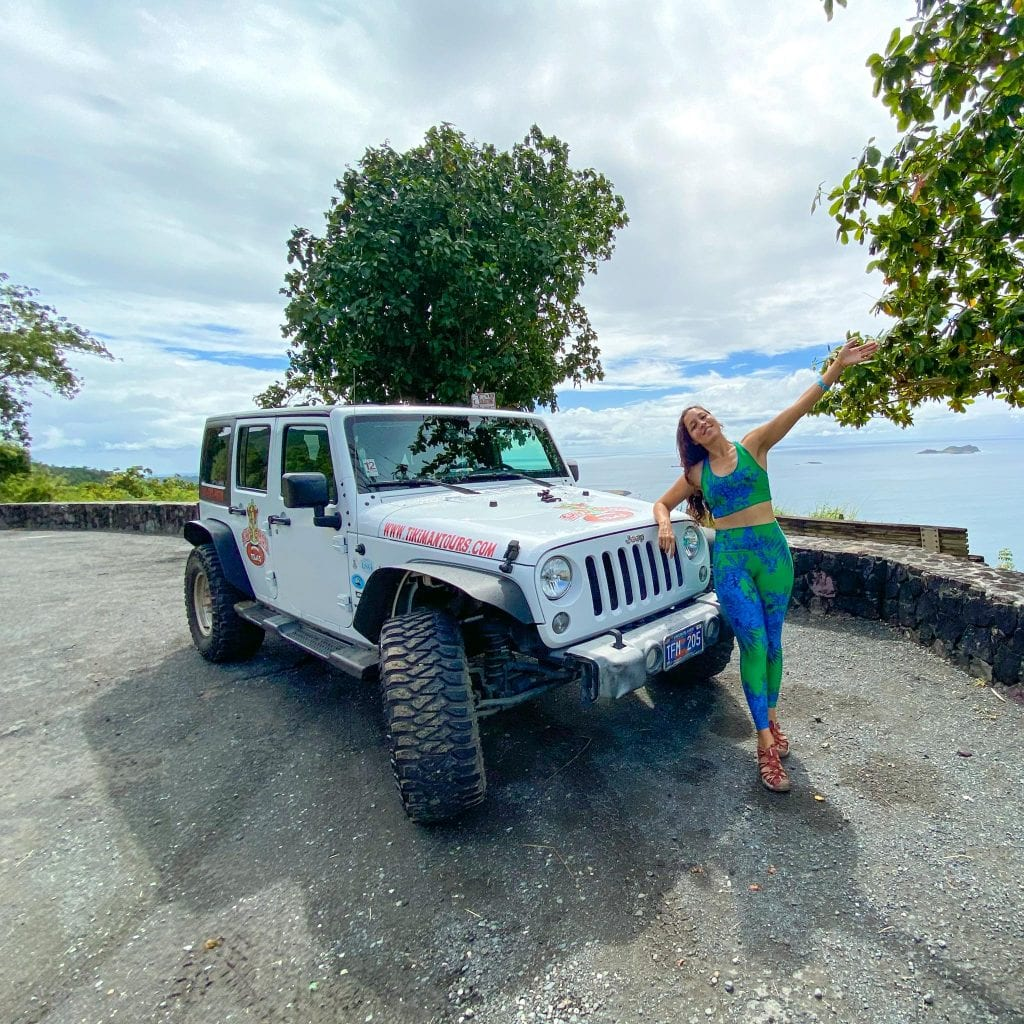 Sarah Fay in front of the Tikiman tour jeep overlooking the beautiful views of St. Thomas! Things to do in St. Thomas, USVI.