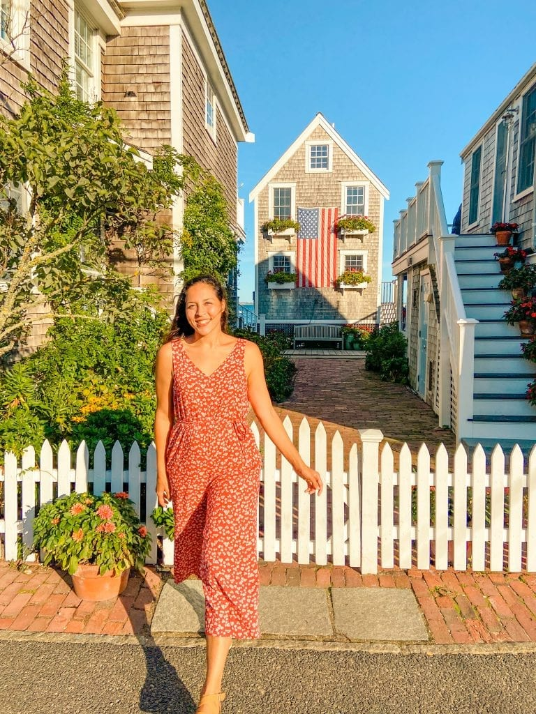 Sarah Fay in front of the flag house, the best towns in cape cod.