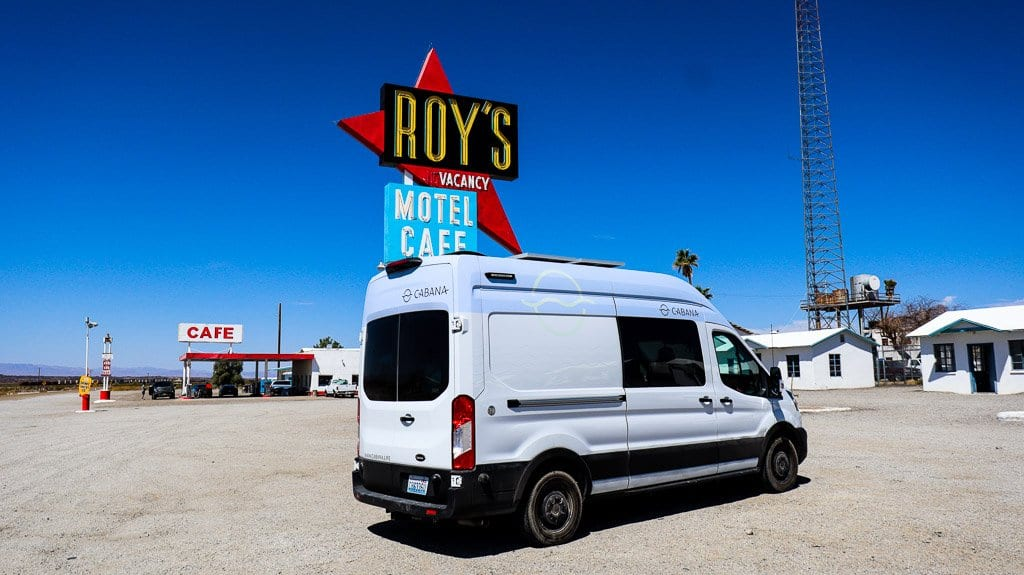 Route 66 quirky road side stops like Roy's make for a great road trip. best van life rental to see what life in a van is like